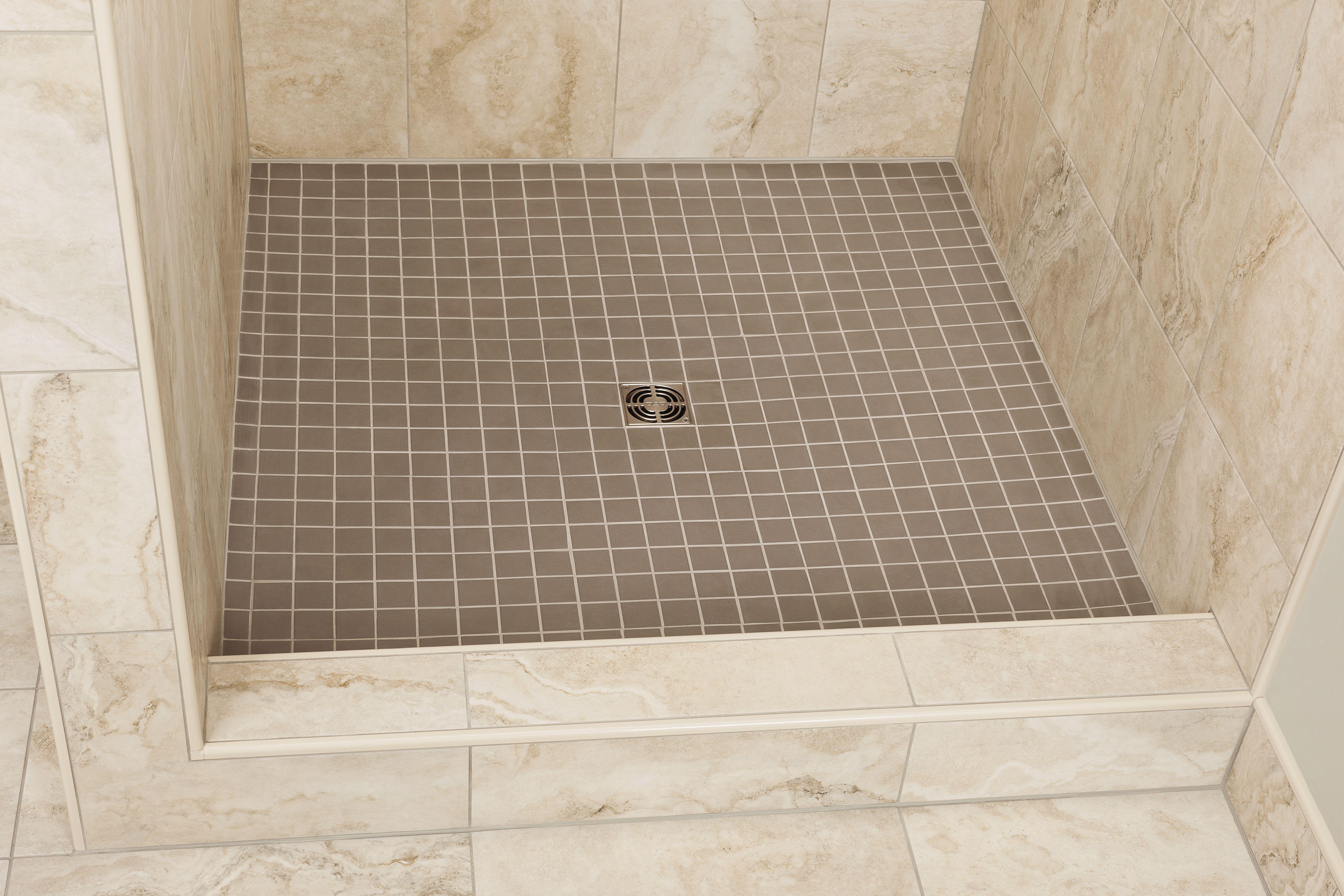 Pebble floor tiles shower