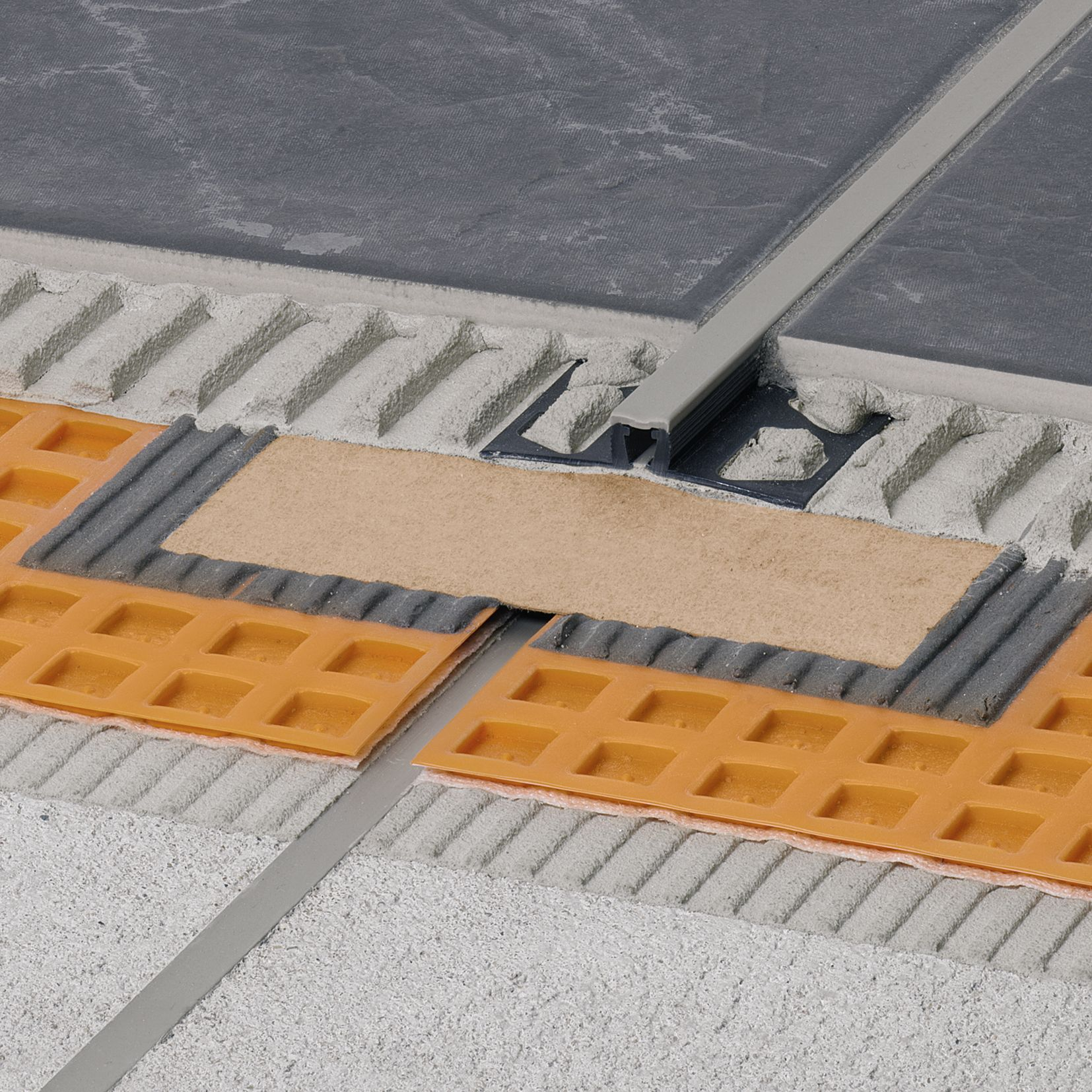 Essential water management in exterior tile installations schluter regardless of the installation method used movement joints must be provided in the tile layer to accommodate the expansion and contraction associated with dailygadgetfo Images