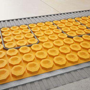 chauffage du carrelage jusqu 70 plus rapide sur b ton. Black Bedroom Furniture Sets. Home Design Ideas