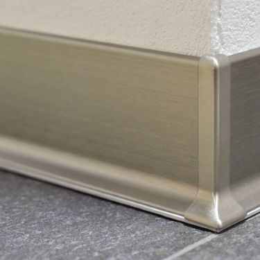 A New Type Of Baseboard For Tiled Floors Schluter