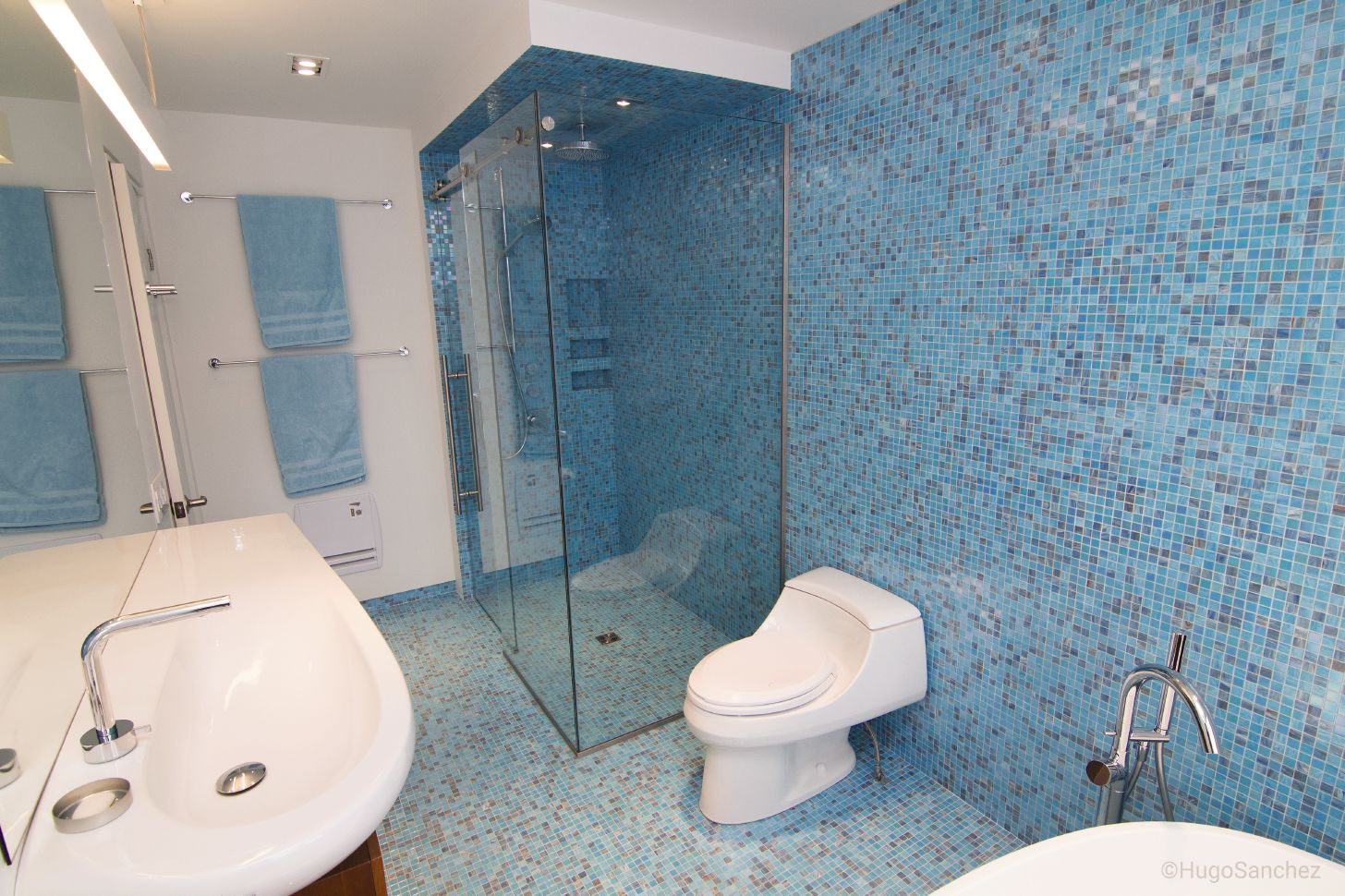 Waterproofing bathroom tile - It S Hard To Tell Where The Walls Begin And The Floor Ends In This Beautiful Blue Tiled Bathroom With Curbless Shower