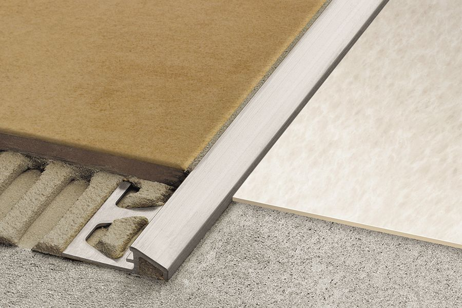 Schluter reno u sloped transitions for floors for Wood floor transition strips