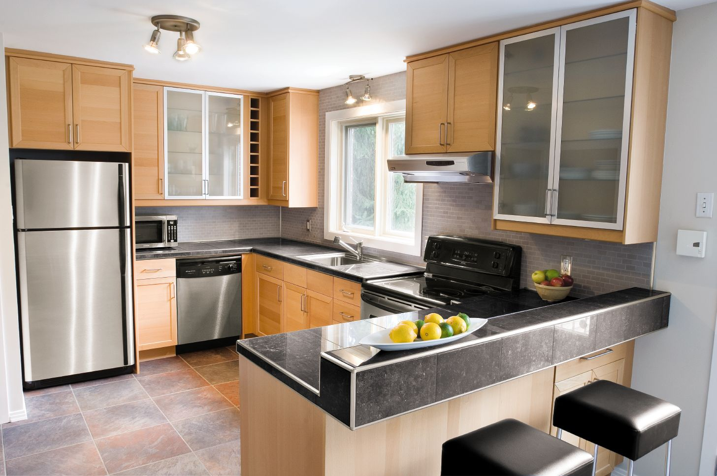 Contemporary kitchen schluter subway tiles on the backsplash porcelain tiles with granite look and brushed aluminum profiles match the appliances creating this contemporary kitchen doublecrazyfo Images