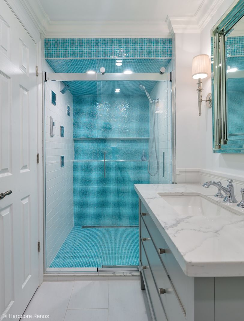 This Stunning Shower Room Is A Beautiful Mix Of Blue Mosaic, Crisp White  Tile, And A Speckled Marble Sink Surround. To Ensure A Flawless  Installation, ...